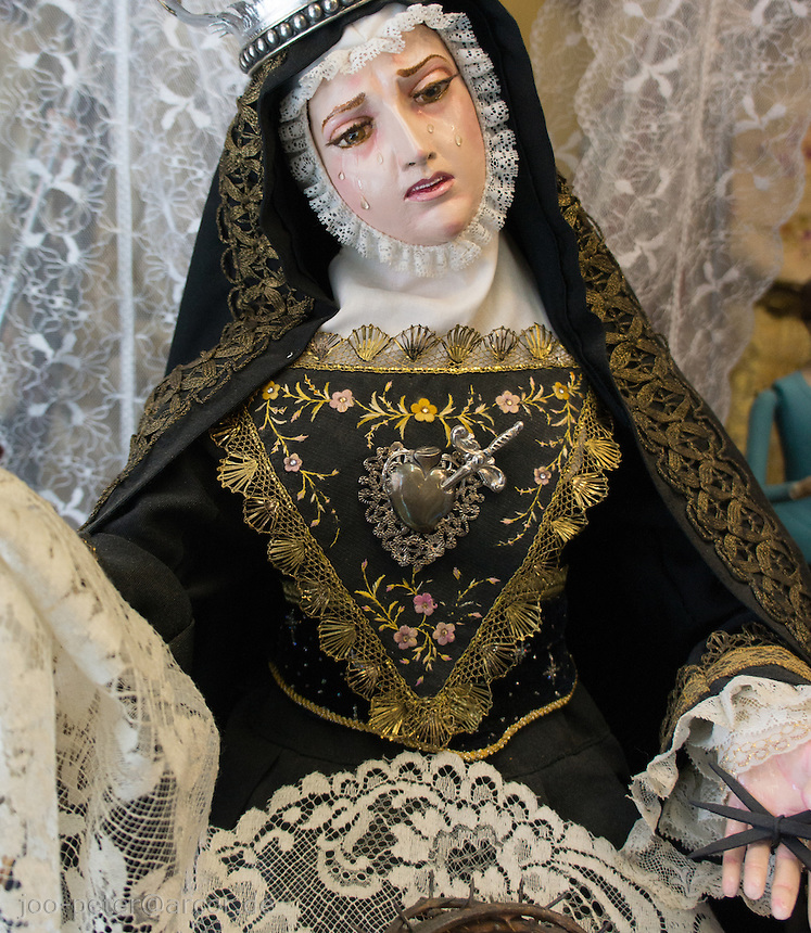 sculpture of Madonna in a black, white and gold dress, Granada, Spain