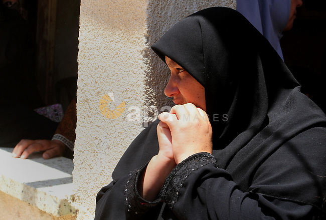 """Palestinian relatives and friends mourn during the funeral of Salah al-Astal, a member of the Islamic Jihad's armed wing -the Al-Quds Brigades- who died after a tunnel collapse in the Gaza Strip, on July 19, 2016 in Khan Younis in the southern Gaza Strip. The Al-Quds Brigades announced in a statement that Salah al-Astal had died during the """"collapse of a resistance tunnel,"""" a term used by Islamic Jihad, Hamas and other Palestinian militant factions to refer to tunnels used in the conflict with Israel. Since January 26, at least 14 Gazans have been killed in at least seven separate tunnel collapses. Photo by Abed Rahim Khatib"""
