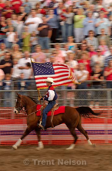 US american flag enters and leaves the arena. West Jordan's Western Stampede rodeo. After 50 years in West Jordan, voters rejected a proposition for a new rodeo grounds, putting the future of the event in question<br />