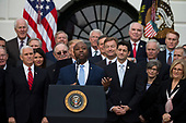 United States Senator Tim Scott, Republican of South Carolina, speaks on the South Lawn of the White House surrounded by United States President Donald J. Trump, United States Vice President Mike Pence, and Republican members of Congress after the United States Congress passed the Republican sponsored tax reform bill, the 'Tax Cuts and Jobs Act' in Washington, D.C. on December 20th, 2017. Credit: Alex Edelman / CNP