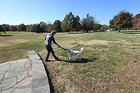 NWA Democrat-Gazette/J.T.WAMPLER Neil Sanders of Bentonville plays with his dog Theodore Monday Nov. 4, 2019 at Gulley Park in Fayetteville. The Fayetteville Parks and Recreation Department plans to put $250,000 next year toward improvements and new features at the park.
