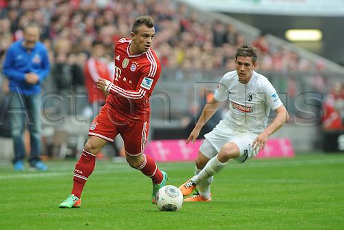 15.02.2014. Munich Germany. Bundesliga football league. Bayern Munich versus SC Freiburg. Xherdan Shaqiri (FC Bayern Muenchen) in challenge with Oliver Sorg (SC Freiburg