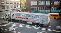 A truck carrying provisions for Domino's Pizza franchises is stopped at a traffic light in the Chelsea neighborhood of New York on Thursday, May 26, 2016. The NYS attorney general is investigating Domino's Pizza and its franchises for systematically undercounting employees work hours.  (© Richard B. Levine)