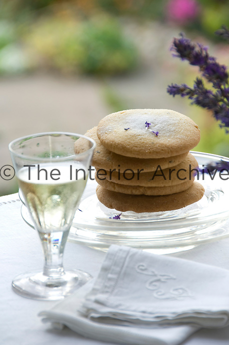 A stack of lavender shortbread and a glass of chilled sweet wine