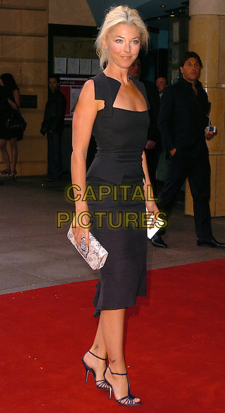 "TAMARA BECKWITH.""The Break Up"" UK film premiere.vue cinema, Leicester Square, London England.14th June 2006.Ref: CAN.full length clutch bag handbag.www.capitalpictures.com.sales@capitalpictures.com.©Can Nguyen/Capital Pictures"