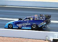 Apr 12, 2015; Las Vegas, NV, USA; NHRA funny car driver Tommy Johnson Jr during the Summitracing.com Nationals at The Strip at Las Vegas Motor Speedway. Mandatory Credit: Mark J. Rebilas-
