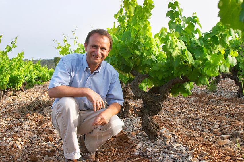 Chateau de Lascaux, Vacquieres village. Pic St Loup. Languedoc. Jean-Benoît Cavalier . Cinsault vine variety. Tourtourelle area. Terroir soil. Owner winemaker. France. Europe. Vineyard. Soil with stones rocks.