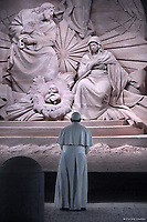 Pope Francis prays in front of a Nativity scene in St Peter's square at the Vatican.December 31,2018