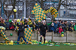 The match referee bursting balloons on the pitch in front of the visiting supporters behind a goal before the Boxing Day derby match between Runcorn Town and visitors Runcorn Linnets at the Pavilions, Runcorn, in a top-of the table North West Counties League premier division match. Runcorn Linnets won 1-0 and overtook their neighbours at the top of the league in a game watched by 803 spectators. Runcorn Linnets were a successor club to Runcorn FC, one of England foremost non-League clubs of the 1970s and 1980s.