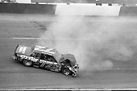 HAMPTON, GA - NOV 3: Sammy Swindell, #72 Pontiac crashes during the Atlanta Journal 500 NASCAR Winston Cup race at Atlanta Motor Speedway, November 3, 1985. (Photo by Brian Cleary/www.bcpix.com)