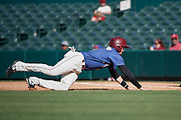 Frisco RoughRiders Josh Altman (5) dives back to first base during a Texas League game against the Amarillo Sod Poodles on May 19, 2019 at Dr Pepper Ballpark in Frisco, Texas.  (Mike Augustin/Four Seam Images)