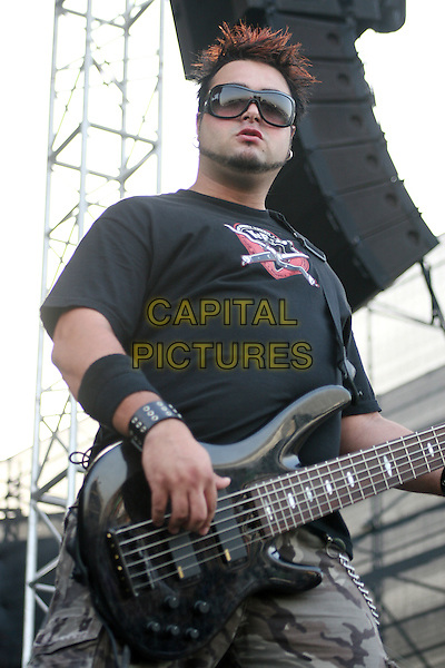 PRIME CIRCLE.Live at the Dubai Desert Rock Festival, Dubai, United Arab Emirates..March 10, 2007.stage concert gig performance music half length black top bass guitar sunglasses shades camouflage trousers .CAP/MAR.© Martin Harris/Capital Pictures.