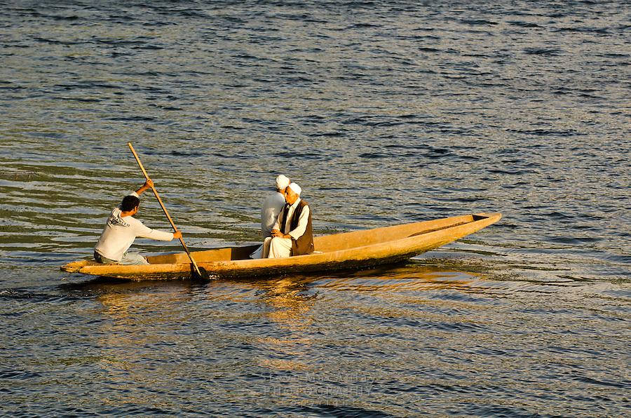 Traditional Kashmiri shikara, or gondola, at sunset, Dal Lake, Srinagar, Kashmir, india.