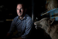 UK. Oxford. 19th November 2015<br /> Professor Greger Larson photographed next to a Wolf at the Oxford Museum of Natural History.<br /> Andrew Testa for the New York Times