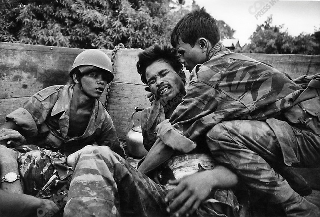Dying Cambodian paratrooper hit by the same mortar that hit Don McCullin, near Phnom Penh, Cambodia, 1970
