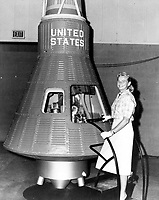 Undated File Photo - Jerrie Cobb poses next to a Mercury spaceship capsule. And, although she never flew in space, Cobb, along with 24 other women, underwent physical tests similar to those taken by the Mercury astronauts with the belief that she might become an astronaut trainee. All the women who participated in the program, known as First Lady Astronaut Trainees (FLAT), were skilled pilots. Dr. Randy Lovelace, a NASA scientist who had conducted the official Mercury program physicals, administered the tests at his private clinic without official NASA sanction. Cobb passed all the training exercises, ranking in the top 2 percent of all astronaut candidates.<br /> <br /> While she was sworn in as a consultant to NASA Administrator James Webb on the issue of women in space, mounting political pressure and internal opposition lead the agency to restrict its official astronaut training program to men despite campaigning by the 13 finalists of the FLAT program. After three years, Cobb left NASA for the jungles of the Amazon, where she has spent four decades as a solo pilot delivering food, medicine, and other aid to the indigenous people. She has received the Amelia Earhart Medal, the Harmon Trophy, the Pioneer Woman Award, the Bishop Wright Air Industry Award, and many other decorations for her tireless years of humanitarian service.