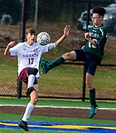 WATERBURY,  CT-101619JS22-  Wilby's Alex Alicia (19) clears the ball in front of Sacred Heart's Zack Warner (17) during their NVL game Thursday at Municipal Stadium in Waterbury. <br />  Jim Shannon Republican-American