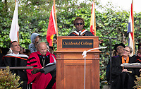 Conferring of Honorary Degree and Response - Olamide U. Ajose '87, Senior Policy Adviser for Higher Education for Governor Gavin Newsom.<br /> Families, friends, faculty, staff and distinguished guests celebrate the class of 2019 during Occidental College's 137th Commencement ceremony on Sunday, May 19, 2019 in the Remsen Bird Hillside Theater.<br /> (Photo by Marc Campos, Occidental College Photographer)