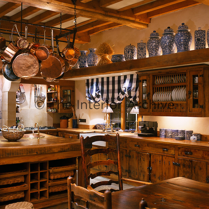 This country kitchen presents a wealth of storage ideas and display possibilities