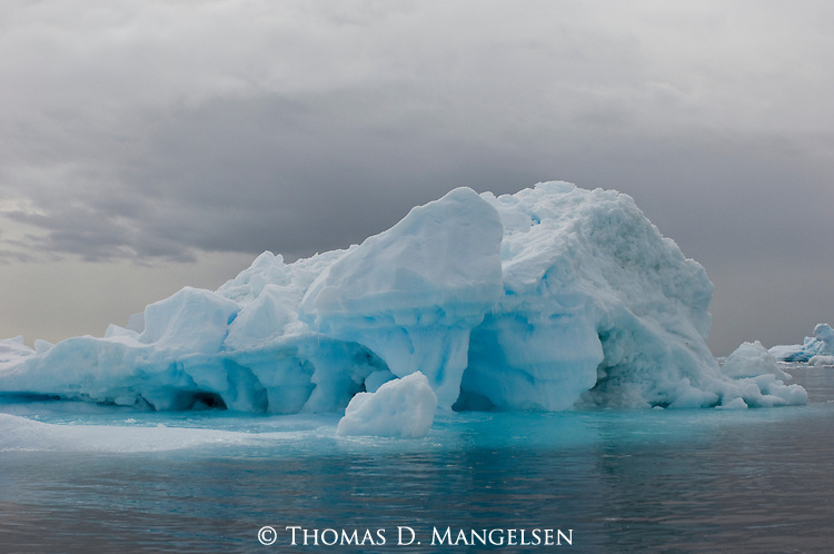 A large iceberg towers above the water off the Vernadsky Station, in Antarctica.