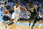 27 December 2014: North Carolina's Isaiah Hicks (22) and UAB's C.J. Washington (25). The University of North Carolina Tar Heels played the University of Alabama Birmingham Blazers in an NCAA Division I Men's basketball game at the Dean E. Smith Center in Chapel Hill, North Carolina. UNC won the game 89-58.