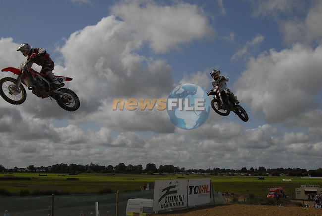 Julien Bill l. (SUI) and Jonathan Barragan r. (ESP) take off together at the table top jump in the MX1 Grand Prix Race1 during the Motocross Grand Prix at Fairyhouse Race Course, Co.Meath, Ireland, 31st August 2008.(Photo Eoin Clarke/Newsfile)