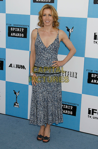 FELICITY HUFFMAN .The 2007 Independent Spirit Awards held at the Santa Monica Pier, Santa Monica, California, USA..February 24th, 2007.full length blue white paisley dress pattern hand on hip .CAP/ADM/RE.©Russ Elliot/AdMedia/Capital Pictures