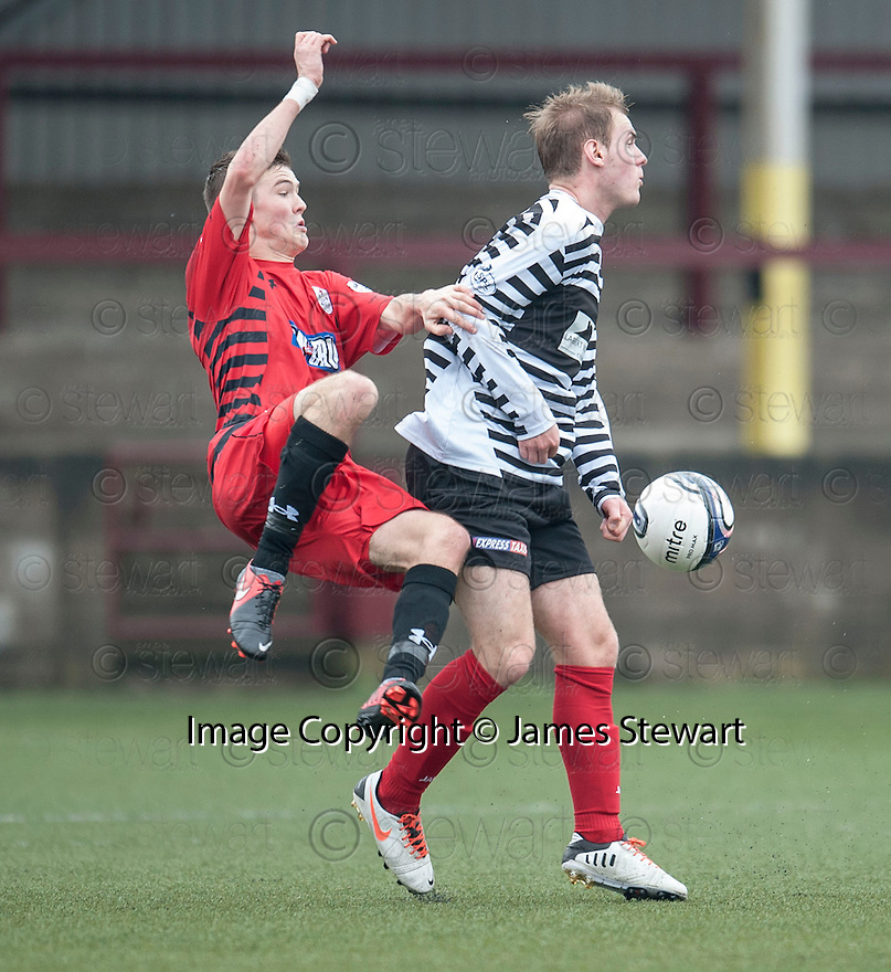 Queen's Park Blair Spittal is bundled off the ball by Shire's Graeme McGregor.