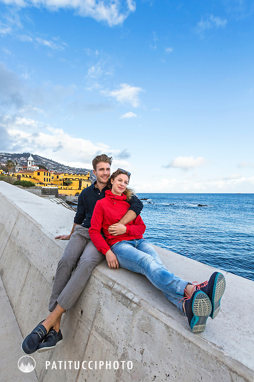 A couple traveling on Madeira Island explores the capitol city of Funchal's waterfront