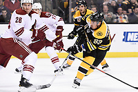 March 13, 2014 - Boston, Massachusetts , U.S. - Boston Bruins left wing Brad Marchand (63) and Phoenix Coyotes defenseman Michael Stone (26) in game action during the NHL game between the Phoenix Coyotes and the Boston Bruins held at TD Garden in Boston Massachusetts. The Bruins defeated the Coyotes 2-1 in regulation time. Eric Canha/CSM