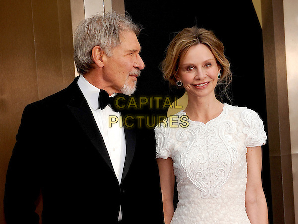 HOLLYWOOD, CA - MARCH 2: Harrison Ford, Calista Flockhart arriving to the 2014 Oscars at the Hollywood and Highland Center in Hollywood, California. March 2, 2014. <br /> CAP/MPI/COR<br /> &copy;Corredor99/ MediaPunch/Capital Pictures