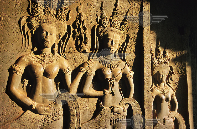 Apsaras gallery at Angkor Wat. Angkor Archaeological Park outside Siam Reap contains numerous temples and ruins. Most famous is the Angkor Wat, a temple built by King Suryavarman II. Originally built in honourof the Hindu gods Shiva, Brahma and Vishnu, the temple was later dedicated to Buddhism.