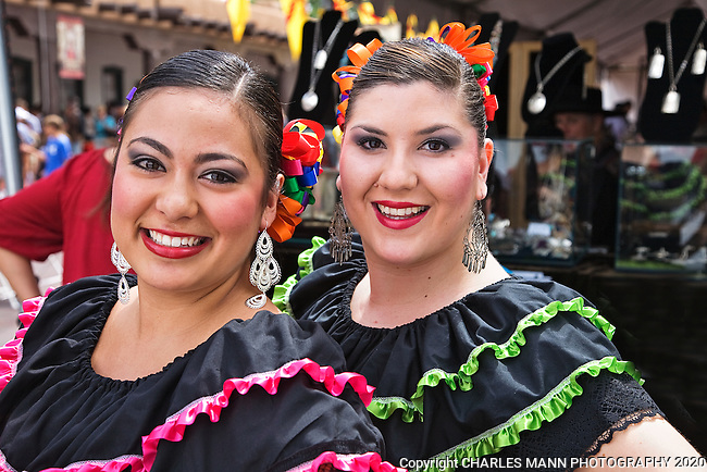 The Santa Fe Spanish Market, held in July, fills the Santa Fe Plaza with artists parton and visitors all celebrating traditional Spanish colonial arts. It is held side by side with the Contemporary Spanish Market which features modern Hispanic artists. Dancers Marilyn Valencia and Elysha Chavez await their turn to perform at the 2011 Spanish Market.