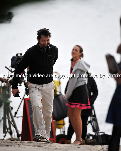 20th August, 2014 SYDNEY AUSTRALIA<br /> EXCLUSIVE <br /> Pictured, Former Home and Away actor, Danny Raco is now one of  the Directors on Home and Away with  Demi Harman and Alec Snow of Home and Away doing scenes at  Palm Beach  and the Barrenjoey Boat Hire.<br /> <br /> *No internet without clearance*.MUST CALL PRIOR TO USE +61 2 9211-1088. Matrix Media Group.Note: All editorial images subject to the following: For editorial use only. Additional clearance required for commercial, wireless, internet or promotional use.Images may not be altered or modified. Matrix Media Group makes no representations or warranties regarding names, trademarks or logos appearing in the images.