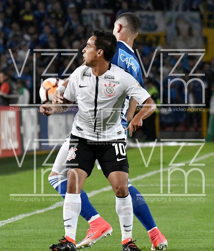 BOGOTA - COLOMBIA – 28 - 02 - 2018: Matias de los Santos (Der.) jugador de Millonarios (COL), disputa el balon con Jadson (Izq.) jugador de Corinthians (BRA), durante partido entre Millonarios (COL) y Corinthians (BRA), de la fase de grupos, grupo 7, fecha 1 de la Copa Conmebol Libertadores 2018, en el estadio Nemesio Camacho El Campin, de la ciudad de Bogota. / Matias de los Santos (R) player of Millonarios (COL), figths for the ball with Jadson (L) player of Corinthians (BRA), during a match between Millonarios (COL) and Corinthians (BRA), of the group stage, group 7, 1st date for the Conmebol Copa Libertadores 2018 in the Nemesio Camacho El Campin stadium in Bogota city. VizzorImage / Luis Ramirez / Staff.