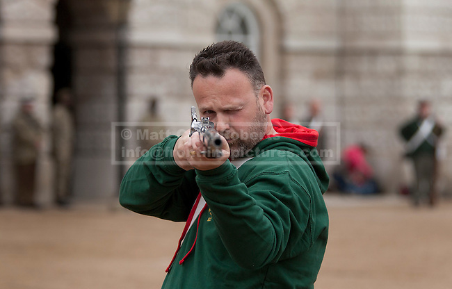 12/06/2012. LONDON, UK. A reenactor of the 'Moscow Militia' aims his musket during a dress rehearsal ahead of the annual Beating Retreat ceremony on Horse Guard's Parade today (12/06/12). Photo credit: Matt Cetti-Roberts