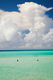 BERMUDA. Southampton Parish. A couple walking in the shallow water.