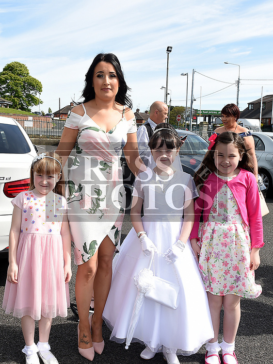 Grace Kinsella from St Brigids school who received her Fiirst Holy Communion in Our Lady of Lourdes church pictured with mam Catherine and sisters Emily and Caitlin. Photo:Colin Bell/pressphotos.ie