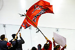 19 MAR 2016: Wis.-River Falls fans cheer by waving their flag during the Division lll Women's Ice Hockey Championship, held at the Ronald B. Stafford Ice Arena in Plattsburgh, NY. Plattsburgh defeated Wis.-River Falls 5-1 for the national title. Wis.-River Falls fans wave flags and cheer their team. Nancie Battaglia/NCAA Photos