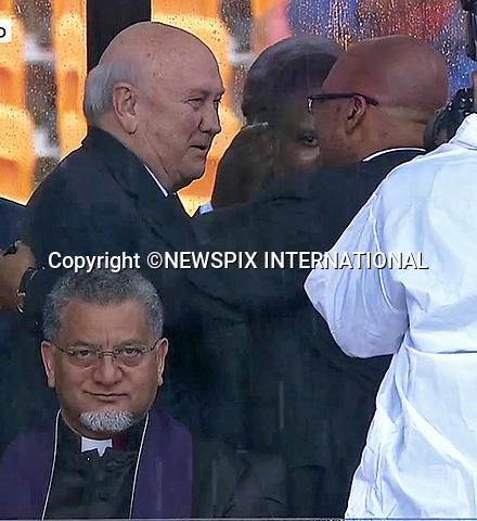 PRESIDENT ZUMA HUGS FORMER PRESIDENT F W DE KLERK<br /> NELSON MANDELA MEMORIAL<br /> The nation mourns Nelson Rolihlahla Mandela Memorial Service, FNB Stadium, Johannesburg, South Africa<br /> Mandatory Credit Photo: &copy;NEWSPIX INTERNATIONAL<br /> <br /> **ALL FEES PAYABLE TO: &quot;NEWSPIX INTERNATIONAL&quot;**<br /> <br /> IMMEDIATE CONFIRMATION OF USAGE REQUIRED:<br /> Newspix International, 31 Chinnery Hill, Bishop's Stortford, ENGLAND CM23 3PS<br /> Tel:+441279 324672  ; Fax: +441279656877<br /> Mobile:  07775681153<br /> e-mail: info@newspixinternational.co.uk