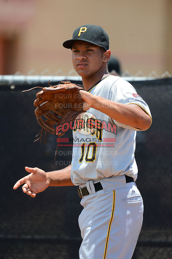 GCL Pirates shortstop Trae Arbet (10) warms up on the side during a game against the GCL Astros on July 16, 2013 at Osceola County Complex in Kissimmee, Florida.  GCL Pirates defeated the GCL Astros 6-3.  (Mike Janes/Four Seam Images)
