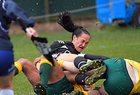 Portia Woodman is tackled during the 2017 International Women's Rugby Series rugby match between the NZ Black Ferns and Australia Wallaroos at Rugby Park in Christchurch, New Zealand on Tuesday, 13 June 2017. Photo: Dave Lintott / lintottphoto.co.nz
