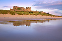 Bamburgh Castle shortly after high tide, Northumberland, UK. July.