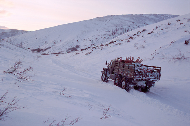An Ural truck carrying food supplies on a winter road in Northern Evensk. Magadan Region, Eastern Siberia, Russia.