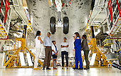 United States President Barack Obama, First Lady Michelle Obama, daughters Malia, left, Sasha, Marian Robinson, Astronaut Janet Kavandi and United Space Alliance project lead for thermal protection systems Terry White, walk under the landing gear of the space shuttle Atlantis as they visit Kennedy Space Center in Cape Canaveral, Florida, Friday, April 29, 2011. .Mandatory Credit: Bill Ingalls / NASA via CNP