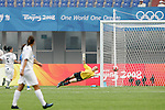 06 August 2008: Jenny Bindon (NZL) (in yellow) dives for a Japan shot that goes wide of the goal.  The women's Olympic team of New Zealand tied the women's Olympic soccer team of Japan 2-2 at Qinhuangdao Olympic Center Stadium in Qinhuangdao, China in a Group G round-robin match in the Women's Olympic Football competition.