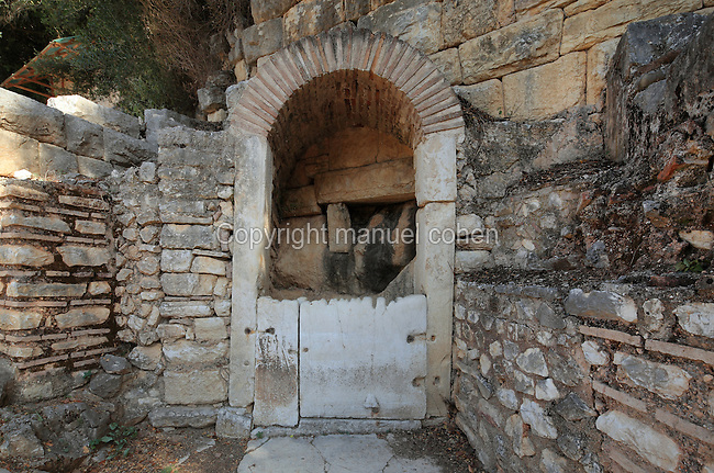 Sacred well, Hellenistic and Roman, near the Theatre in the Roman Forum, built after<br />  Julius Caesar's designation of Butrint as a Roman colony in 1st century BC, Butrint, Chaonia, Albania. The Forum is a monumental open space used for public life, business and worship. It had 3 shrines to the North, is surrounded by porticoes and has a stone pavement. It was discovered by archaeologists in 2005. Butrint was founded by the Greek Chaonian tribe and was a port throughout Hellenistic and Roman times, when it was known as Buthrotum. It was ruled by the Byzantines and the Venetians and finally abandoned in the Middle Ages. The ruins at Butrint were listed as a UNESCO World Heritage Site in 1992. Picture by Manuel Cohen