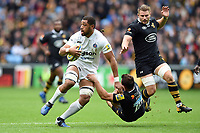 Taulupe Faletau of Bath Rugby fends Rob Miller of Wasps. Aviva Premiership match, between Wasps and Bath Rugby on October 1, 2017 at the Ricoh Arena in Coventry, England. Photo by: Patrick Khachfe / Onside Images