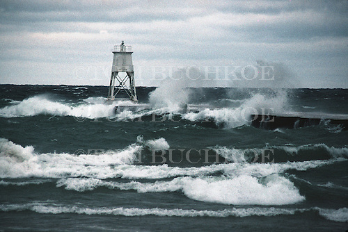 Grand Marais lighthouse on Lake Superior in Michigan's Upper Peninsula, during a fall storm.