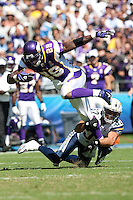 09/11/11 San Diego, CA: Minnesota Vikings running back Adrian Peterson #28 and San Diego Chargers defensive back Eric Weddle #32 during an NFL game played at Qualcomm Stadium between the San Diego Chargers and the Minnesota Vikings. The Chargers defeated the Vikings 24-17.